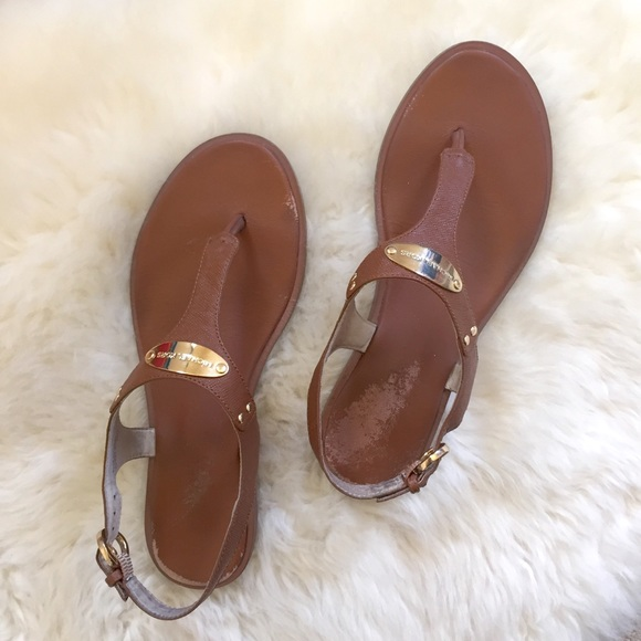 1178daa70e0 MICHAEL Michael Kors Shoes - MICHAEL Michael Kors MK Plate Thong Sandals -  USED